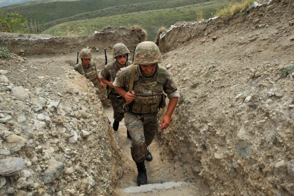 Armenian soldiers of the self-proclaimed republic of Nagorno-Karabagh walk in a trench at the frontline on the border with Azerbaijan near the town of Martakert. EU president Herman Van Rompuy urged last week enemies Armenia and Azerbaijan to end frontline clashes that have raised fears of renewed war over the disputed region of Nagorny Karabakh. Armenia-backed separatists seized Karabakh from Azerbaijan in a war in the 1990s that left some 30,000 dead, and no final peace deal has been signed since the 1994 ceasefire. (Karen Minasyan/Getty Images)