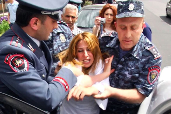 Policemen brought out mayoral candidate Zaruhi Postanjyan from the election headquarters of Taron Margaryan during the city council elections in Yerevan, Armenia