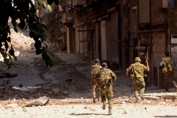 "A handout picture released by the Syrian...A handout picture released by the Syrian Arab News Agency (SANA) on September 24, 2012 shows Syrian government forces running along a street strewn with debris in the northern city of Aleppo during fighting against rebel forces. According to the Syrian Observatory for Human Rights, at least 29,000 people have been killed since the revolt against Assad's rule erupted in March last year. The United Nations puts the toll at more than 20,000.   AFP PHOTO/HO/SANA  == RESTRICTED TO EDITORIAL USE - MANDATORY CREDIT ""AFP PHOTO / HO / SANA"" - NO MARKETING NO ADVERTISING CAMPAIGNS - DISTRIBUTED AS A SERVICE TO CLIENTS ==-/AFP/GettyImages"