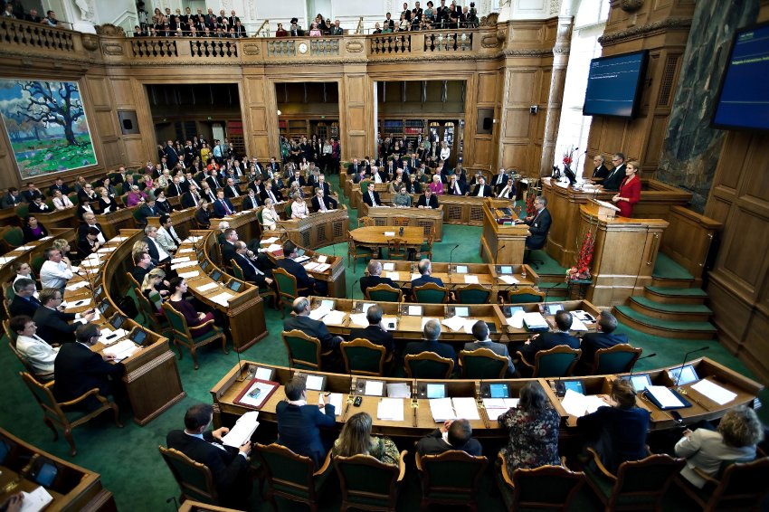 Danish Prime Minister Helle Thorning-Schmidt , at right in red, delivers her speech to mark the opening of a new session of parliament at Christiansborg Palace in Copenhagen on Tuesday, Oct. 4th, 2011. Helle Thorning-Schmidt, the country's first female prime minister, heads an unlikely alliance that includes ex-communists and pro-market liberals and has struggled to chart an economic program. (AP Photo/Polfoto, Lars Krabbe) DENMARK OUT