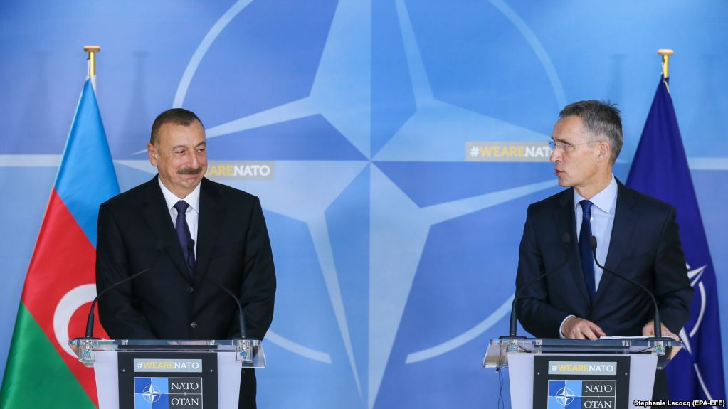 epa06345201 Azerbaijan's President Ilham Aliyev (L) and  North Atlantic Treaty Organization (NATO) Secretary General Jens Stoltenberg (R) give a press conference at the end of a meeting at NATO headquarters in Brussels, Belgium, 23 November 2017.  EPA-EFE/STEPHANIE LECOCQ