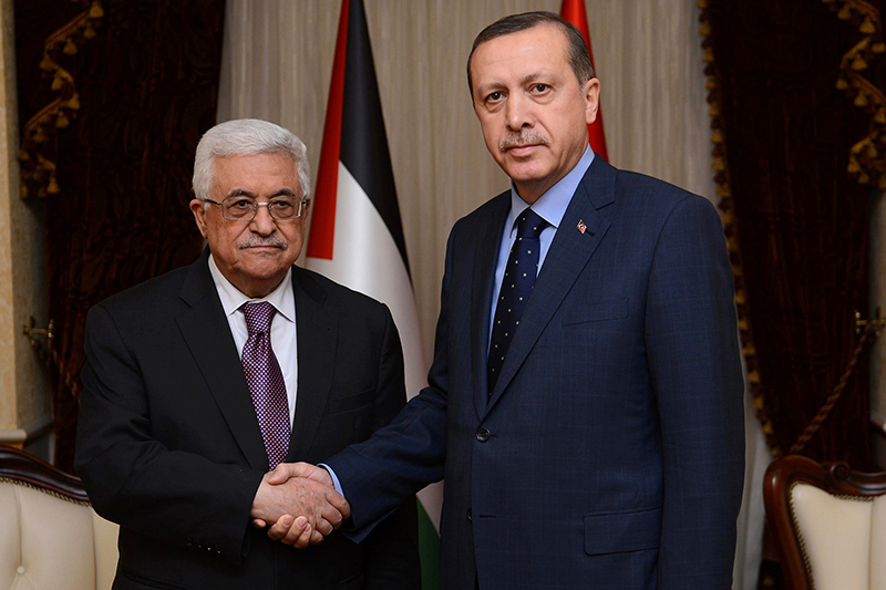 In this photo provided by the Turkish Prime Minister's Press Service, Palestinian President Mahmoud Abbas, left, and Turkish Prime Minister Recep Tayyip Erdogan pose for a photograph before a meeting in Ankara, Turkey, Tuesday, Dec. 11, 2012. Abbas received a welcoming ceremony with a 21-gun salute early in the day in recognition of the Palestinians' new status after the U.N. General Assembly last month voted to recognize the Palestinians as a non-member observer state. (AP Photo/Kayhan Ozer)