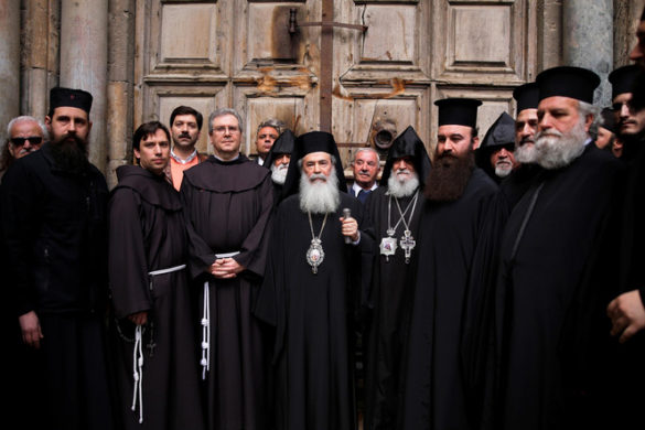 The Custodian of the Holy Land Father Francesco Patton (3rd L) and Greek Orthodox Patriarch of Jerusalem, Theophilos III (C) stand with other church leaders during a news conference in front of the closed doors of the Church of the Holy Sepulchre in Jerusalem's Old City, February 25, 2018. REUTERS/Amir Cohen - RC1B1D036C90