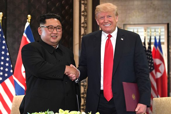 TOPSHOT - US President Donald Trump (R) and North Korea's leader Kim Jong Un shake hands following a signing ceremony during their historic US-North Korea summit, at the Capella Hotel on Sentosa island in Singapore on June 12, 2018.  Donald Trump and Kim Jong Un became on June 12 the first sitting US and North Korean leaders to meet, shake hands and negotiate to end a decades-old nuclear stand-off. / AFP PHOTO / SAUL LOEBSAUL LOEB/AFP/Getty Images