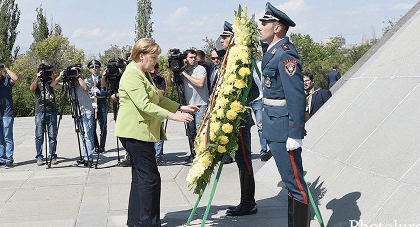 Merkel-Genocide-1