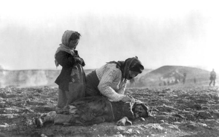 genocide-mother-kneeling