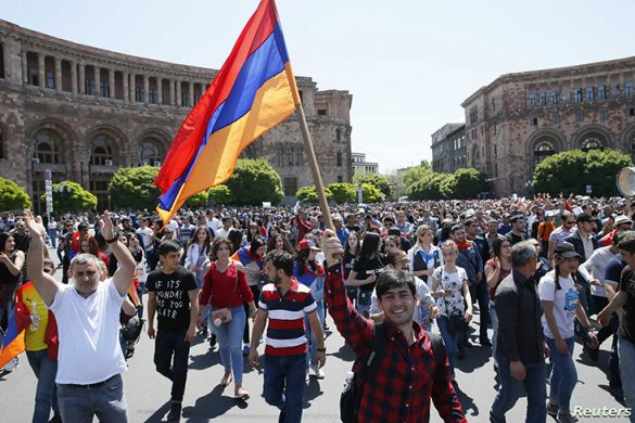 Armenian opposition supporters walk on the street after protest movement leader Nikol Pashinyan announced a nationwide campaign of civil disobedience in Yerevan, Armenia May 2, 2018. REUTERS/Gleb Garanich - UP1EE520OPFSL