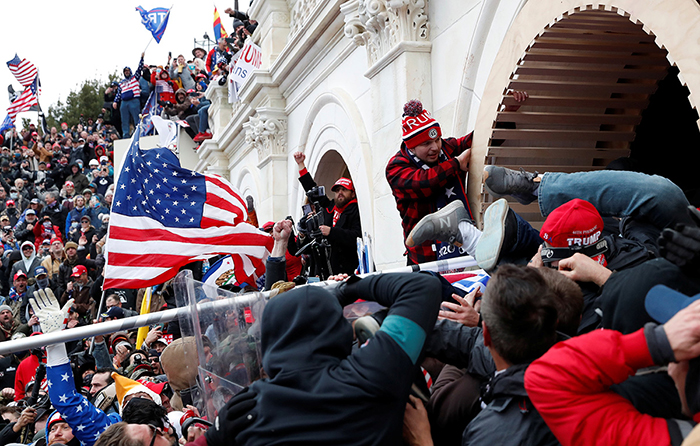 Pro-Trump protesters storm into the U.S. Capitol during clashes with police, during a rally to contest the certification of the 2020 U.S. presidential election results by the U.S. Congress, in Washington, U.S, January 6, 2021. REUTERS/Shannon Stapleton - RC2P2L9YHHVX