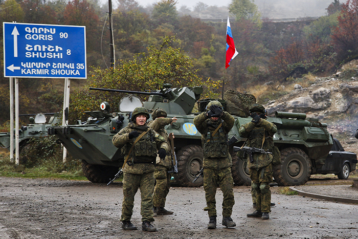 Russian peacekeepers hold up their hands to stop a photo being taken as a checkpoint is set up at the entrance to Stepanakert on Nov. 13. Jack Losh for Foreign Policy