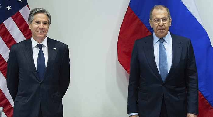 U.S. Secretary of State Antony Blinken, left, poses with Russian Foreign Minister Sergey Lavrov, right, before a meeting at the Harpa Concert Hall in Reykjavik, Iceland, Wednesday, May 19, 2021, on the sidelines of the Arctic Council Ministerial summit. (Saul Loeb/Pool Photo via AP)
