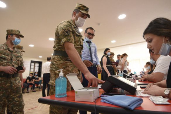 A serviceman prepares to vote at a polling station during early parliamentary elections in Yerevan on June 20, 2021. - Armenians went to the polls on June 20, 2021 in early parliamentary elections which were called in an attempt to heal the country's divisions after a disastrous war with Azerbaijan, but which could spark post-vote protests. (Photo by Karen MINASYAN / AFP)