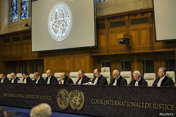 Judge Peter Tomka, President of the International Court of Justice (ICJ) (4th R), presides over the court case verdict regarding a maritime dispute between Chile and Peru at the ICJ in the Hague January 27, 2014. REUTERS/Michael Kooren (NETHERLANDS - Tags: POLITICS MARITIME) - RTX17WXX