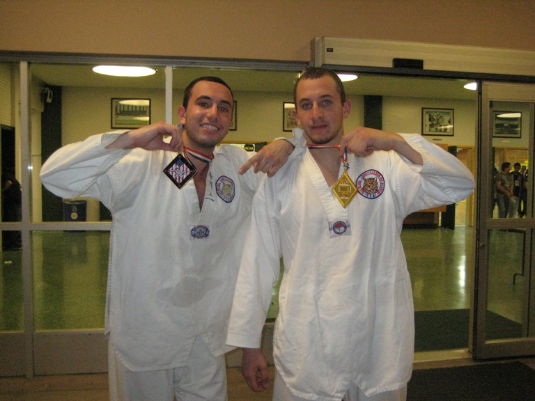 Sarkis (right) and Nareg (left) holding the gold medals