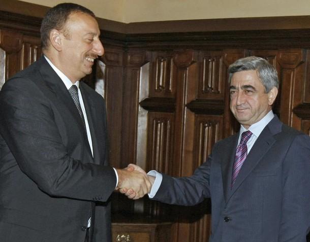 President of Azerbaijan Ilham Aliyev (L)