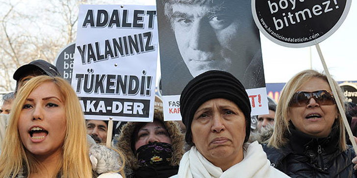 Rakel Dink, wife of Hrant Dink joins hundreds of people as they shout slogans and hold placards that read 'This case won't end this way' outside a courthouse in Istanbul