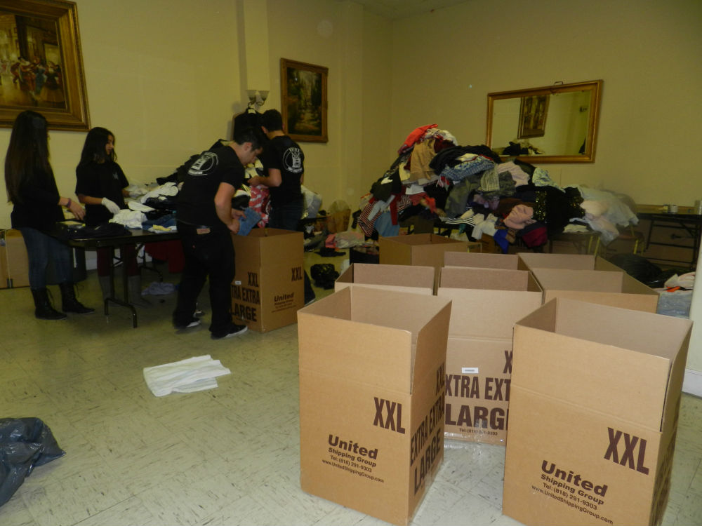 GYO members sorting through and organizing donated cloths for Armenia
