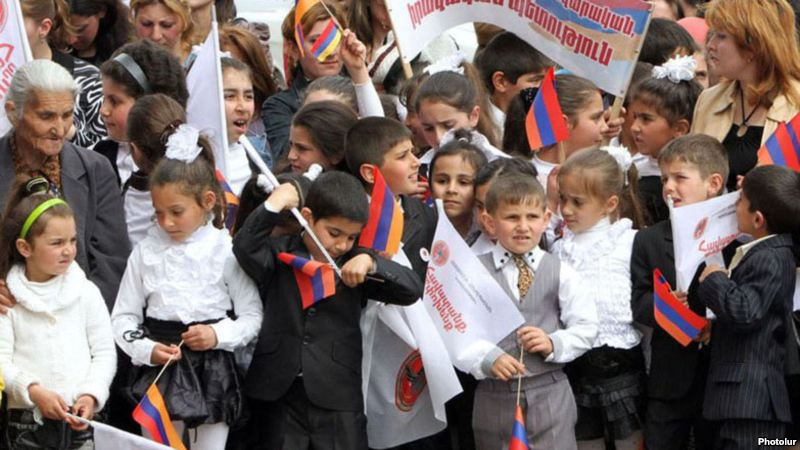 Schoolchildren at an election campaign rally held by the ruling Republican Party in Armavir province