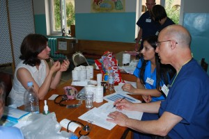 Dr. Al Phillips in consultation with a patient in Vanadzor