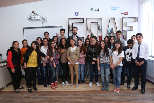 Armenian-American internet entrepreneur Alexis Ohanian, co-founder of social website Reddit, and Sabriya Stukes with students at technology-enhanced Creativity Lab of newly renovated school by Children of Armenia Fund (COAF) located in  Hatsik, Armenia, on Sunday, April 26, 2015. Ohanian visited the COAF-supported villages during his trip to Armenia in commemoration of the centennial of the Armenian Genocide.