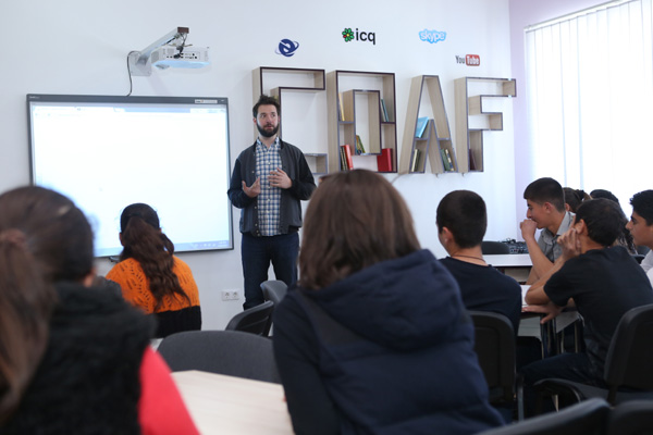 Armenian-American internet entrepreneur Alexis Ohanian, co-founder of social website Reddit, meeting with students at technology-enhanced Creativity Lab of newly renovated school by Children of Armenia Fund (COAF) located in  Hatsik, Armenia, on Sunday, April 26, 2015. Ohanian visited the COAF-supported villages during his trip to Armenia in commemoration of the centennial of the Armenian Genocide.