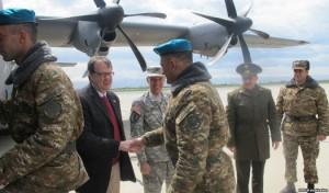U.S. Ambassador Richard Mills shakes hands of Armenian soldiers boarding a U.S. military transport plane in Yerevan