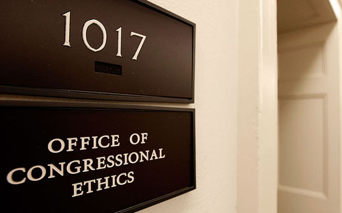 "WASHINGTON - OCTOBER 30:  A sign for the Office of Congressional Ethics hangs on a wall October 30, 2009 in Washington, DC. A document from the House of Representatives ethics committee inadvertently placed on a publicly accessible computer network outlined investigations into the activities of 30 lawmakers from the House. The  22-page document, titled ""Committee on Standards Weekly Summary Report,"" was discovered on a file-sharing computer server and also outlined investigations by the Office of Congressional Ethics, a quasi-independent body that initiates investigations and provides recommendations to the ethics committee. (Photo by Chip Somodevilla/Getty Images)"