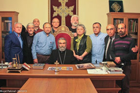 His Eminence Archbishop Barkev Mardirossian, Primate of Artsakh surrounded by a group of intellectuals. R.Marashli and Ali Erdem seen in the 1st row and Sarkis Hatspanian in the 2nd row