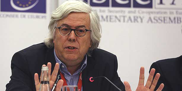 Andreas Gross, head of a delegation of parliamentarians from the Council of Europe and member of the International election observers, speaks to the media a day after an election in Turkey, in Ankara, Turkey, Monday, Nov. 2, 2015. International election observers on Monday noted that elections were free and peaceful but criticized media restrictions in the run-up to the vote, including the seizure by the government of an opposition media company and criminal investigations of journalists for allegedly supporting terrorism or defaming Erdogan. (AP Photo/Burhan Ozbilici)