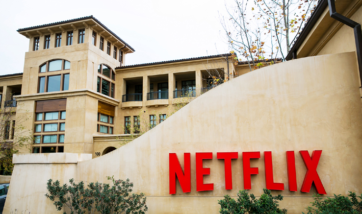 A logo sign outside the headquarters of Netflix, Inc., in Los Gatos, California on December 7, 2014. Photo Credit: Kristoffer Tripplaar/ Sipa USA *** Please Use Credit from Credit Field ***