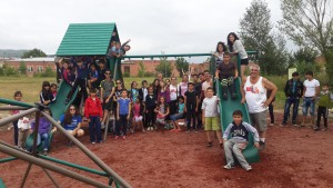 SERVICE Armenia participants and local children in Vanadzor following the construction of the Vanadzor Park play structure.