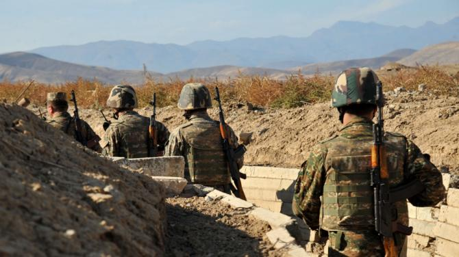 Armenian soldiers of the self-proclaimed republic of Nagorno-Karabagh walk in trenches at the frontline on the border with Azerbaijan, on October 25, 2012. Armenia-backed separatists seized Karabakh from Azerbaijan in a war in the 1990s that left some 30,000 dead, and no final peace deal has been signed since the1994 ceasefire. AFP PHOTO /  KAREN MINASYAN