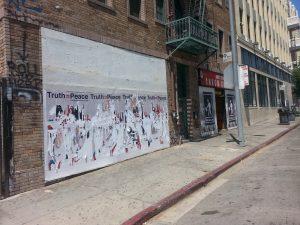 Remnants of denialist posters adjacent to Congressman Adam Schiff's disctrict office