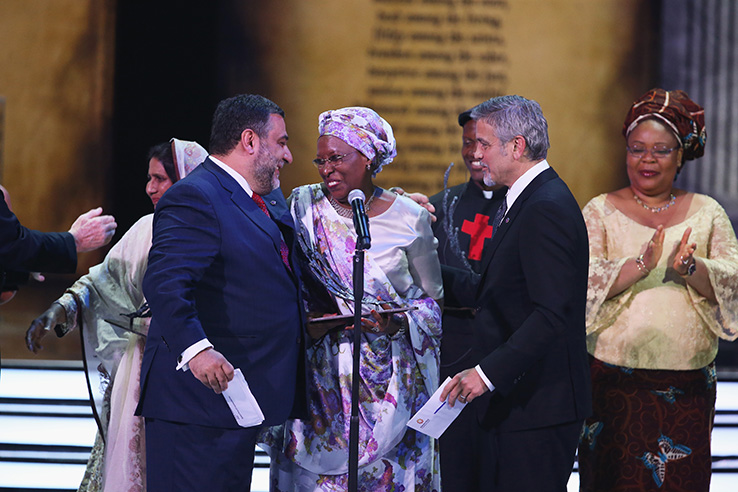 YEREVAN, ARMENIA - APRIL 24:  Marguerite Barankitse accepts the inaugural Aurora Prize for Awakening Humanity from George Clooney, Co-Chair of the Selection Committee with Ruben Vardanyan, Co-Founder of the Aurora Prize at the presentation ceremony on April 24, 2016 in Yerevan, Armenia.  (Photo by Andreas Rentz/Getty Images for 100 Lives) *** Local Caption *** Marguerite Barankitse;George Clooney;Ruben Vardanyan