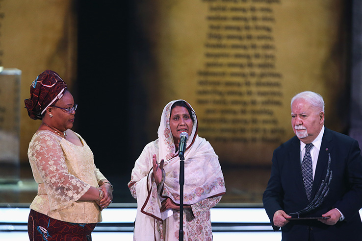 Aurora Prize Selection Committee Members Leymah Gbowee and Vartan Gregorian listen to Aurora Prize Finalist Syeda Ghulam Fatima at the Aurora Prize Ceremony in Yerevan
