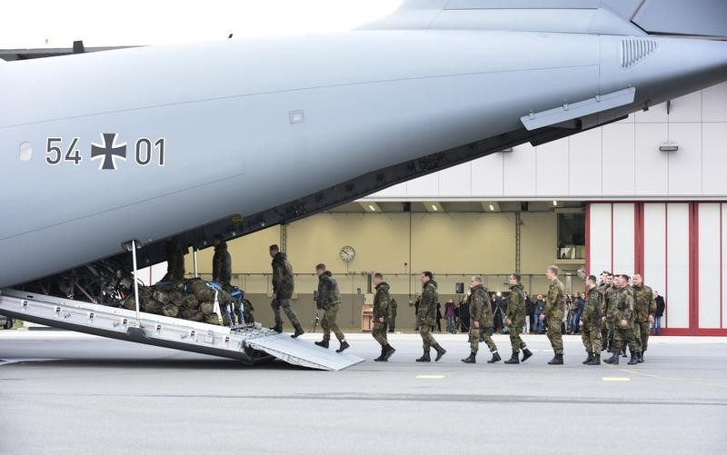 Army personnel board a German airforce Airbus A400M military aircraft at German army Bundeswehr airbase in Jagel, northern Germany December 10, 2015. REUTERS/Fabian Bimmer