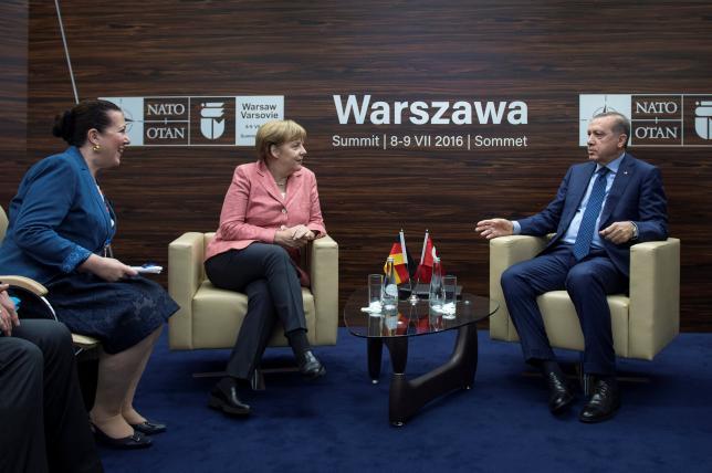 Germany's Chancellor Angela Merkel meets with Turkey's President Tayyip Erdogan at the NATO Summit in Warsaw, Poland July 9, 2016.  Bundesregierung/Guido Bergmann/Handout via REUTERS