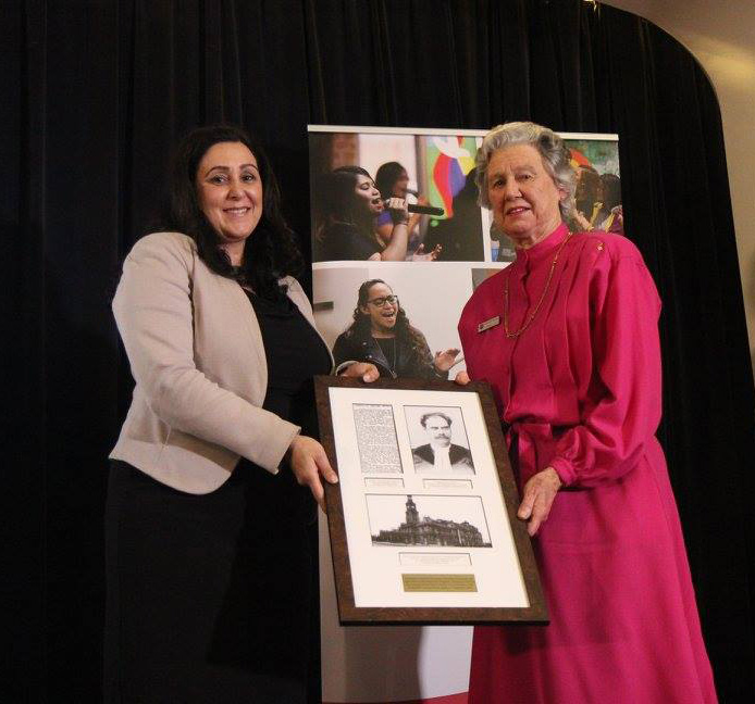 Nora Grigorian granddaughter of Mihran Terzian one of the orphans at the Australasian Orphanage paying tribute to Rev. John Ferguson by presenting a gift to Margaret Warden, great grand daughter of Rev. Ferguson. Rev. Ferguson at the time the minister of St. Stephens Presbyterian Church currently Uniting. The hall where the e vent is held is named after him